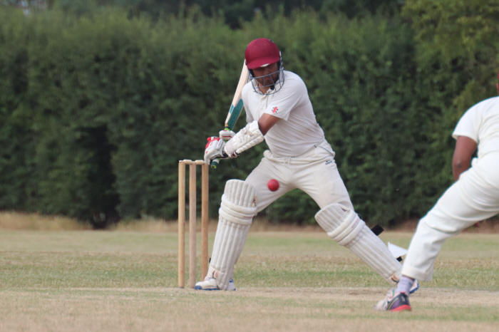 Hassan Khan prepares to strike the ball
